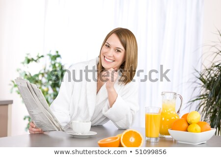 blonde in modern kitchen with juice Stock photo © ssuaphoto
