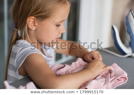 little blond hair girl ironing stock photo © aikon