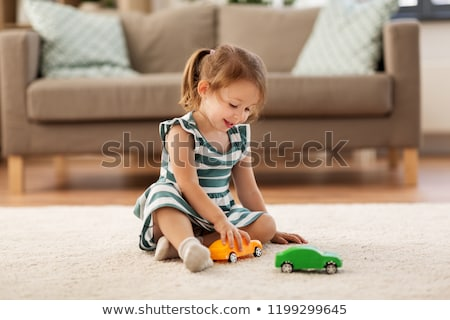 Stock photo: little girl with toys
