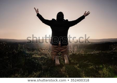 Férfi térdel fű mező portré park Stock fotó © photography33