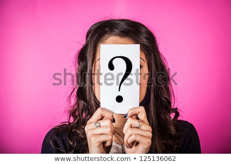 Beautiful woman with questioning expression and question marks a stock photo © HASLOO