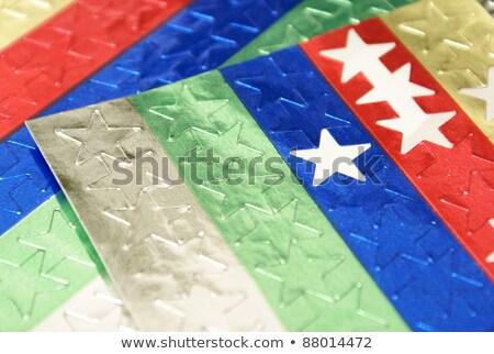 Lap színes csillag matricák extrém közelkép Stock fotó © CrackerClips