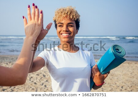 fitness enthusiast stretching her arms stock photo © stockyimages
