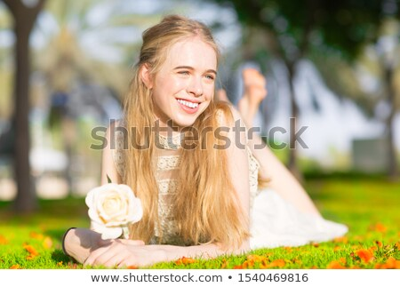 Stock photo: Beautiful girl at the park daydreaming