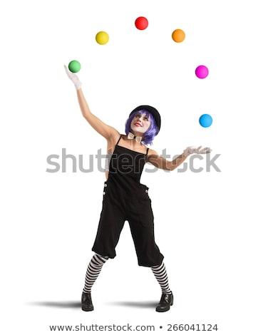 Circus Act: Clown balancing on ball Stock photo © mintymilk