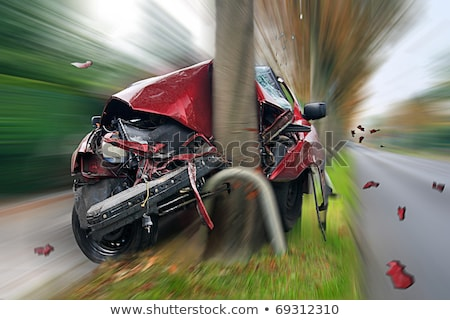 accident   car crashed into tree stock photo © kzenon