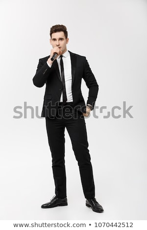 Homme sur micro costume Photo stock © adrian_n