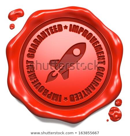 Improvement Guaranteed - Stamp on Red Wax Seal. Stock photo © tashatuvango
