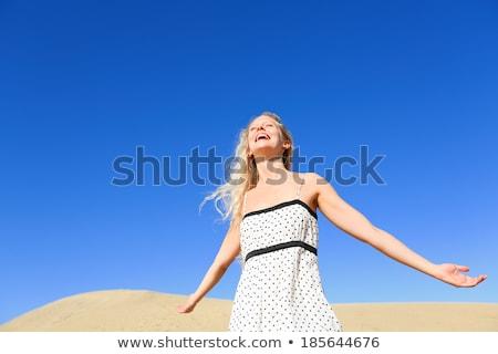 Foto d'archivio: Sun Skin Care Woman Enjoying Desert Sunshine