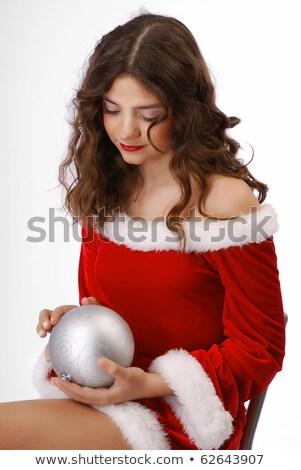 Pensive teenage girl with christmas ball stock photo © o_p_m