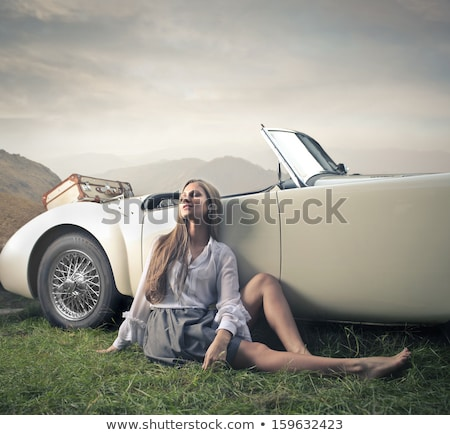 attractive blond woman sitting in the old car stock photo © nejron