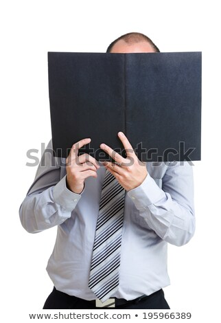 Businessman holding file pad and cover his face Stock photo © stockyimages