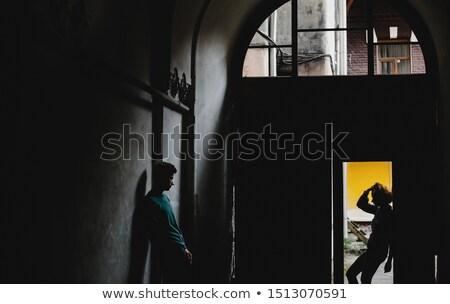 Güzel bayan ayakta kapı delik gündelik Stok fotoğraf © FAphoto