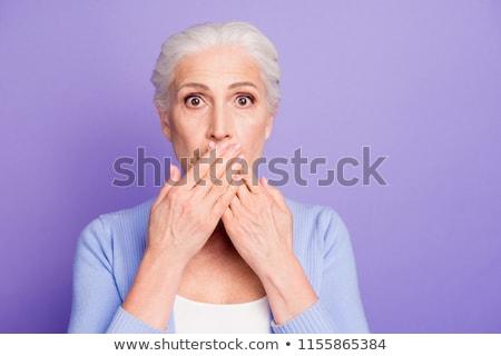 Rijpe vrouw hand mond schok portret schoen Stockfoto © bmonteny
