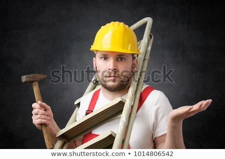 Awkward repairman with hammer Stock photo © icefront