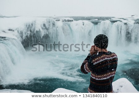 icelandic sweater man by waterfall on iceland stock photo © maridav