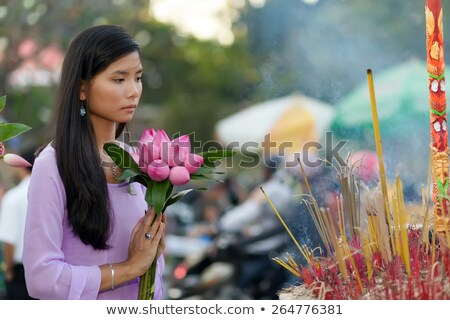 Vietnamese woman holding lotus bunch Stock photo © smithore