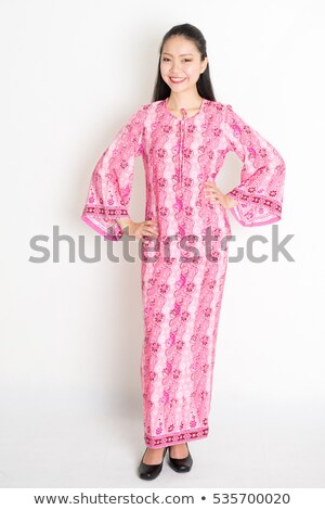 Asian woman in pink batik dress Stock photo © szefei