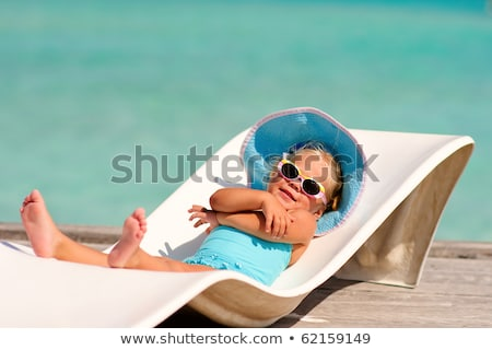 Girls sunbathing on the deckchair Stock photo © deandrobot