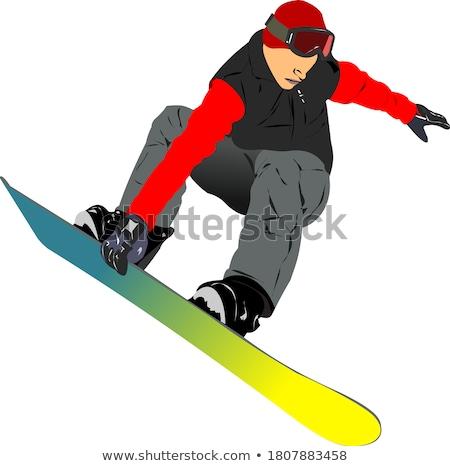 Boy snowboarder in mountains. Stock photo © iofoto