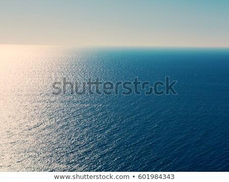 Minimalista tengeri kilátás szürkület hosszú expozíció víz naplemente Stock fotó © Juhku