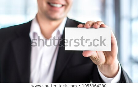 Stock photo: Young manager holding a empty white board