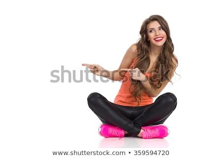 Glimlachend jonge vrouw shirt broek vrouwelijke geslacht Stockfoto © dolgachov