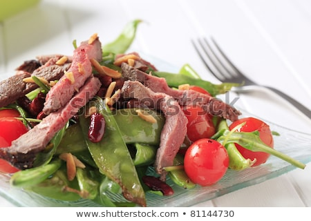 roast beef with snow peas and arugula stock photo © digifoodstock