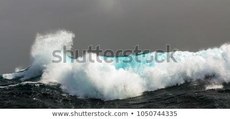 Zeegolf storm pier oceaan golven wolken Stockfoto © hlehnerer