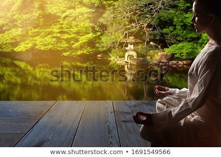 Donna bianco robe seduta esterna Foto d'archivio © dash