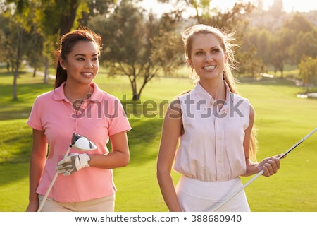 Smiling friendly woman golfer walking on a course Stock photo © dash