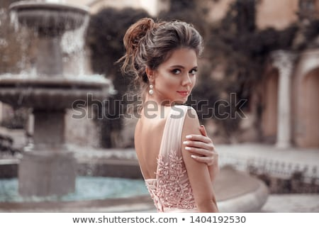 Stock photo: young lady wearing gorgeous dress