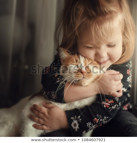Little girl hugging pet kitten Stock photo © bluering