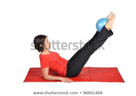 Kecses fiatal fitnessz nő nyújtás piros fitt Stock fotó © deandrobot