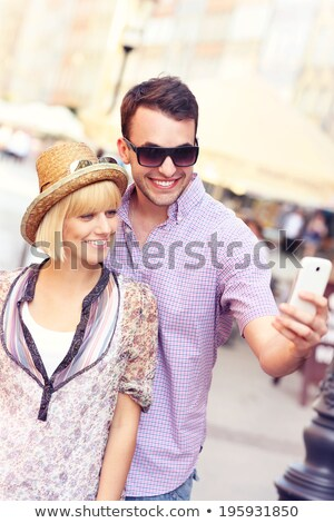 Two women taking selfie with mobile phone in old city Stock photo © deandrobot