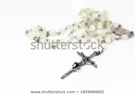 Pearl necklace crucifix on white stock photo © luissantos84