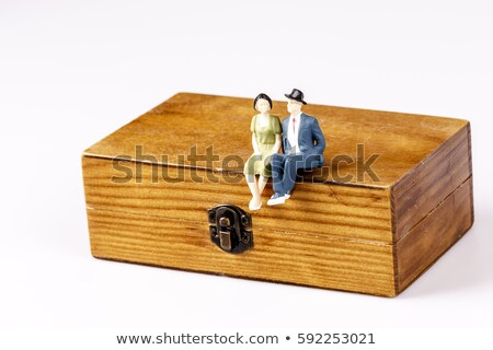 toy models of old couple sitting on wooden box stock photo © jarin13