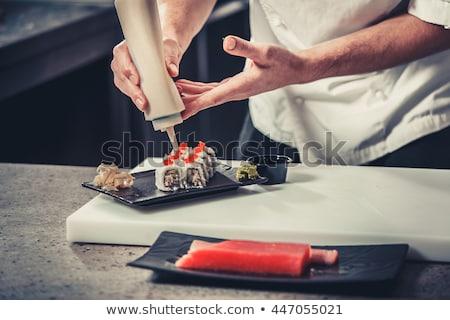férfi · szusi · kezek · érintés · bambusz · kicsi - stock fotó © o_lypa