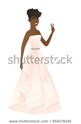 African fiancee showing the victory gesture. Stock photo © RAStudio