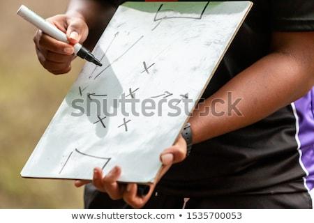 Trenerem schemat kobiet posiedzenia Zdjęcia stock © wavebreak_media