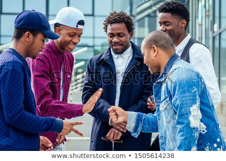 Young african-american traveler laughing out loud. Stock photo © RAStudio