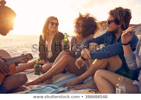happy woman with bottle of drink on summer beach stock photo © dolgachov
