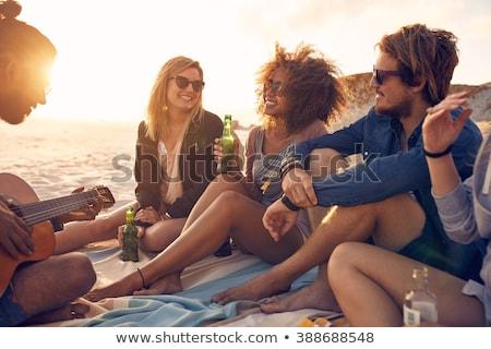 Felice donna bottiglia bere estate spiaggia Foto d'archivio © dolgachov