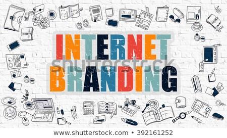 brand strategy concept multicolor on white brickwall stock photo © tashatuvango