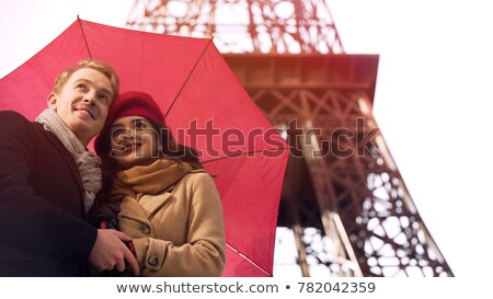 Beautiful woman waiting for boyfriend, romantic date in Paris on rainy day stock photo © motortion