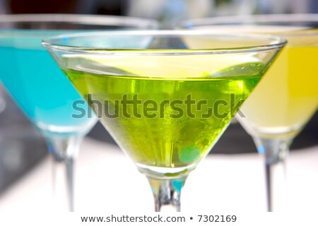 Glasses with martini and green olives Stock photo © dashapetrenko