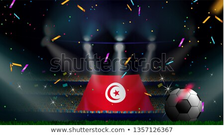 Man with flag of tunisia in a crowd Stock photo © MikhailMishchenko