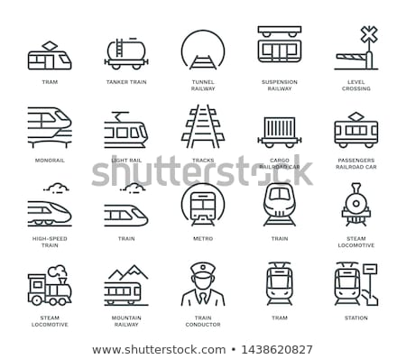 Train and wagons crossing a railway station Stock photo © FreeProd