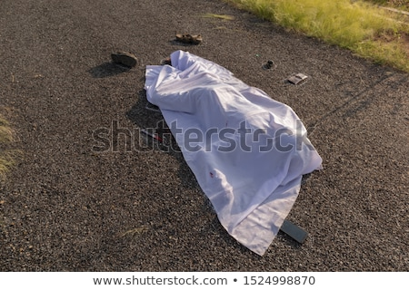 Stockfoto: Criminal With Knife And Dead Body At Crime Scene