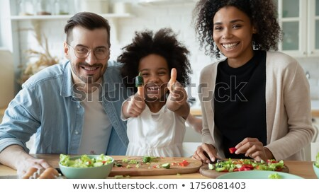 couple posing with child stock photo © is2
